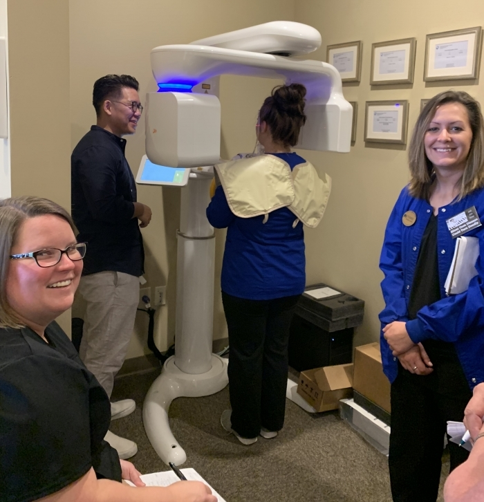 FACD staff being trained on new Dental Cone Beam Tomography X-ray Machine